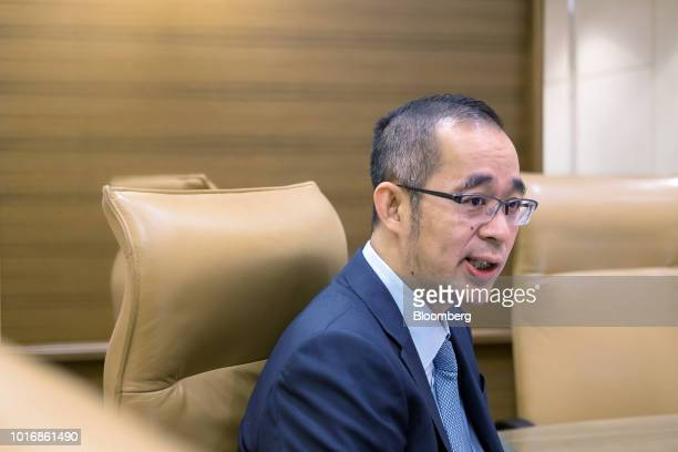 Lai Shixian chief financial officer of Anta Sports Products Ltd poses for a photograph in Hong Kong China on Tuesday Aug 14 2018 Anta is looking to...