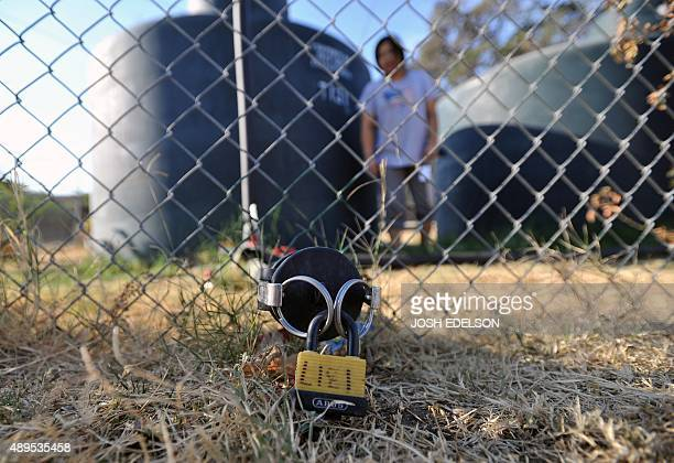 Lai Srisounthone stands near a water tank's locked spout at her mother's home in Porterville California on September 21 2015 California State...