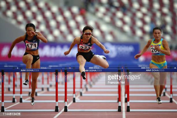 Lai Yiu Lui of Hong Kong Ayako Kimura of Japan and Aygerim Shynazbekova of Kazakhstan compete in the Women's 100m Hurdles race during Day Four of the...
