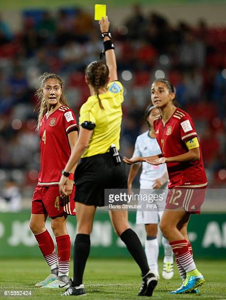 Laia Aleixandri of Spain receives a yellow card from referee MarieSoleil Beaudoin during the FIFA U17 Women's World Cup Semi Final match between...