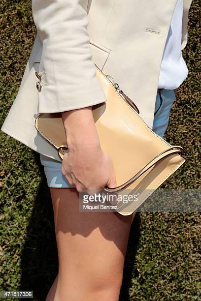 Laia bag detail wears a Genuine Paper Carta from Panama Polaroid sunglasses Zara's jacket and white shirt a Burberry belt RDisplay trousers Mari Paz...