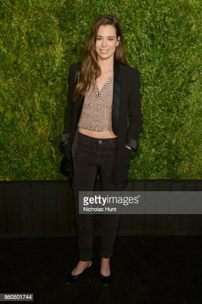 Laia Costa wears a black wool crepe jacket and charcoal stretch denim jeans, Look 61, with a salmon and black cotton tweed vest, Look 6, all from the...