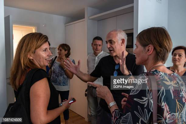 Laia Ortiz from the Department of Social Rights of the Barcelona City Council is seen talking with the architects Jaime Coll and Judith Leclerc in...