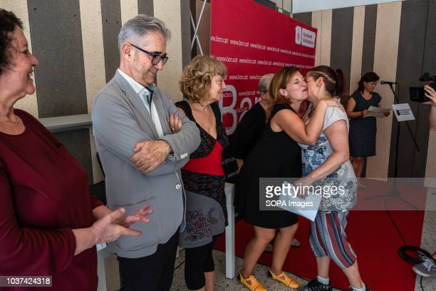 Laia Ortiz of the Department of Social Rights of the City of Barcelona is seen kissing a new resident during the hand over event Handing over of 47...