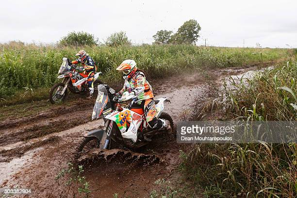 Laia Sanz of Spain riding on and for KTM 450 RALLY REPLICA KTM RACING TEAM and Olivier Pain of France riding on and for KTM 450 RALLY REPLICA NOMADE...