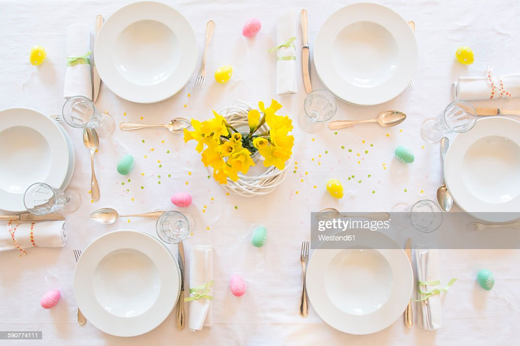 Laid Easter table with bunch of daffodils : ストックフォト