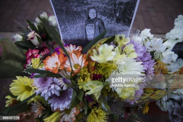 Laid flowers are seen during the vigil at Lake Anne Plaza for Nabra Hassanen who was murdered Sunday on her way back to an overnight event at the All...