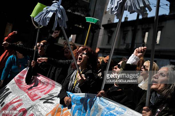 Laid off cleaning staff of the Finance Ministry take part in a demonstration in Athens on March 12 during a 24hours strike by public sector's...