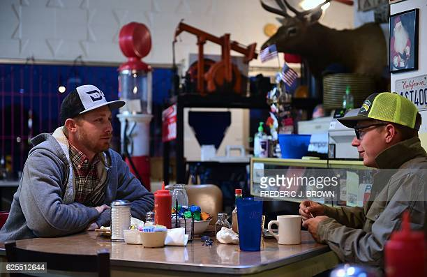 Laid off oil field worker Burt Reynolds and his friend professional bull rider Lane Selz finish breakfast at Pappy's Coffee Shop popular with Kern...