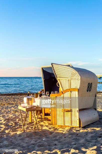 laid table and hooded beach chairs at the beach in the evening, heiligendamm, germany - heiligendamm stock photos and pictures