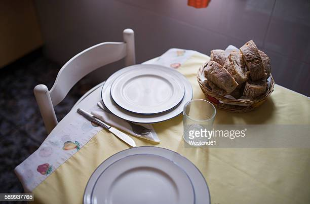 Laid table for two persons with bread basket