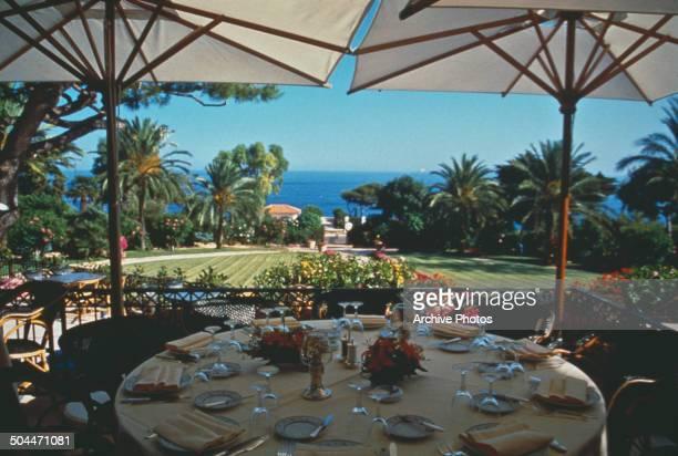 A laid table overlooking the coast at the Grand Hotel du Cap Ferrat at SaintJeanCapFerrat in southeastern France circa 1965