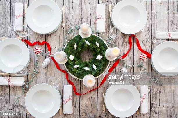 laid table with advent wreath and christmas decoration - advent stock-fotos und bilder