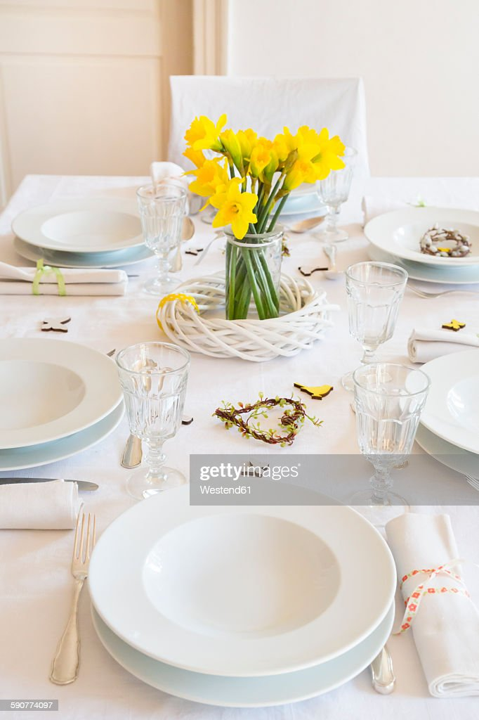 Laid table with daffodils at springtime : ストックフォト