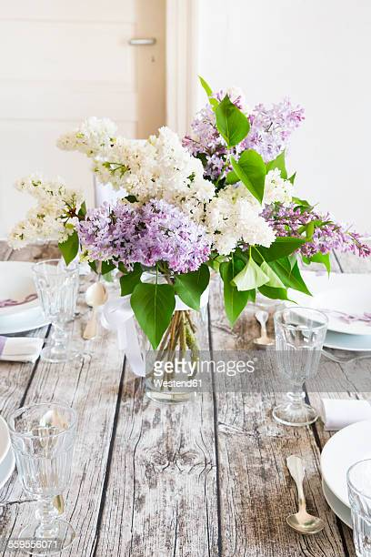 Laid table with lilac