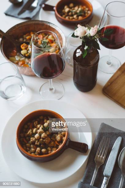 Laid table with Mediterranean soup and red wine