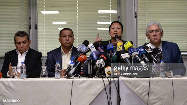 Laidy Gomez elected governor of Tachira state talks during a press conference next to elected governor of Merida state Ramon Guevara elected governor...
