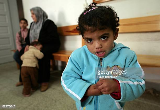 Laila age three who suffers from chronic anemia waits to see a doctor at the Ard El InsanTerres de Homme clinic on April 6 2006 in Gaza City Gaza...