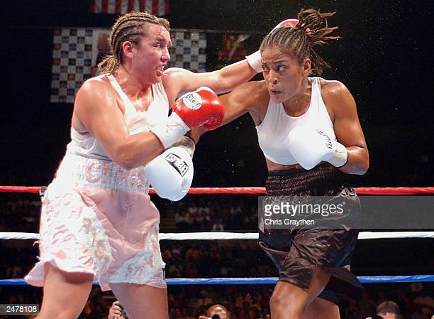 Laila Ali and Christy Martin exchange blows on August 23 2003 at the Mississippi Coast Coliseum in Biloxi Mississippi Ali knocked out Martin in the...