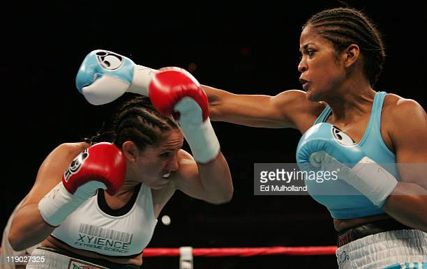 Laila Ali and Erin Toughill trade punches during their 10 round WBC/WIBA Super Middleweight title bout at the MCI Center in Washington DC Ali won the...