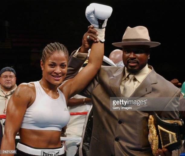 Laila Ali and her husband Yahya celebrate after the fight on August 23 2003 at Mississippi Coast Coliseum in Biloxi Mississippi Laila defeated...