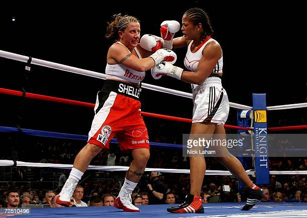 Laila Ali and Shelley Burton exchange blows during the WBC Super Middleweight Championship bout on November 11 2006 at Madison Square Garden in New...
