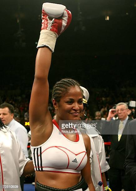 Laila Ali celebrates her win over Shelley Burton during the WBC Super Middleweight Championship bout on November 11 2006 at Madison Square Garden in...