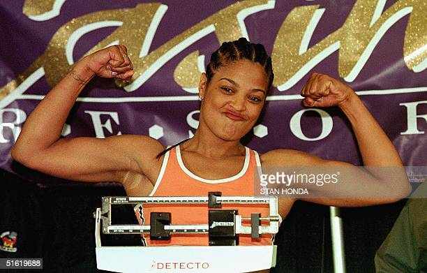 Laila Ali daughter of boxing great Muhammad Ali poses during her weighin 07 October at the Turning Stone Casino Resort in Verona New York one day...