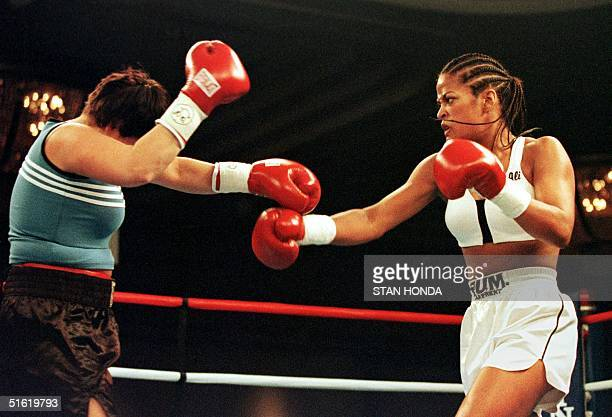 Laila Ali daughter of boxing great Muhammad Ali throws a punch as April Fowler of Michigan City Indiana tries to cover up during their match 08...
