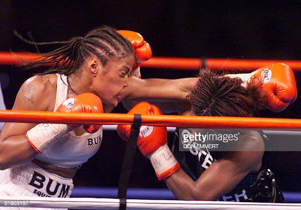 Laila Ali gets hits on the side of the head by Jacqui FrazierLyde as she throws a punch during their women's Super Middleweight fight 08 June 2001 at...