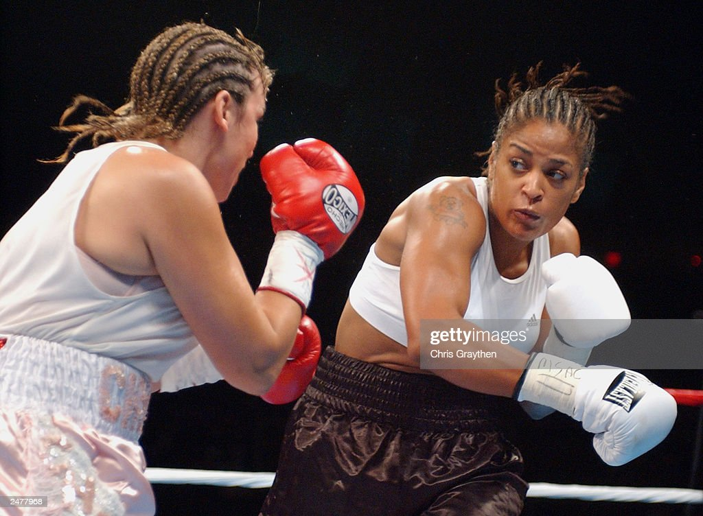 Laila Ali keeps her eyes on Christy Martin on August 23, 2003 at the Mississippi Coast Coliseum in Biloxi, Mississippi. Ali knocked out Martin in the fourth round.