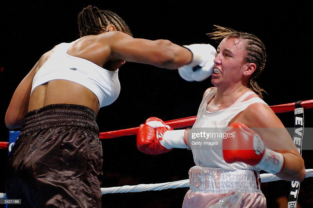 Laila Ali lands a punch on Christy Martin on August 23, 2003 at the Mississippi Coast Coliseum in Biloxi, Mississippi. Ali defeated Martin in the fourth round.
