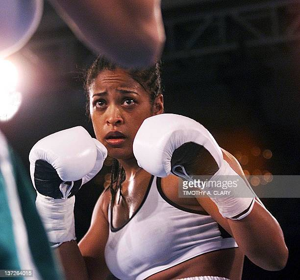 Laila Ali of Los Angeles and daughter of boxing great Muhammad AlI keeps her hands up during her sixround bout with Christine Robinson of Lexington...