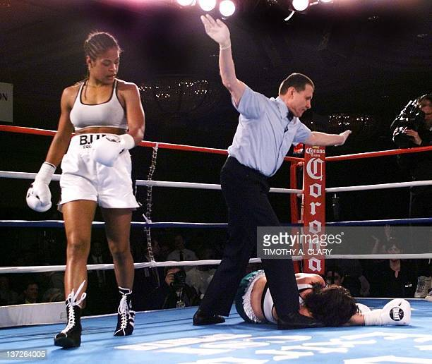 Laila Ali of Los Angeles and daughter of boxing legend Muhammad Ali walks away after her knock out Christine Robinson of Lexington KY in the fifth...