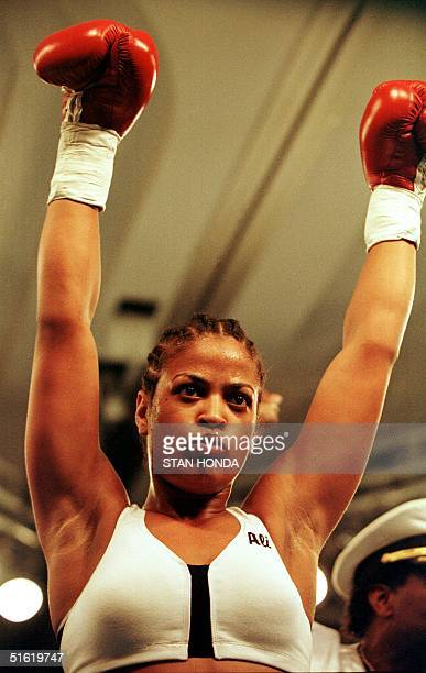 Laila Ali of Los Angeles daughter of boxing great Muhammad Ali celebrates her victory over April Fowler of Michigan City Indiana after their match 08...