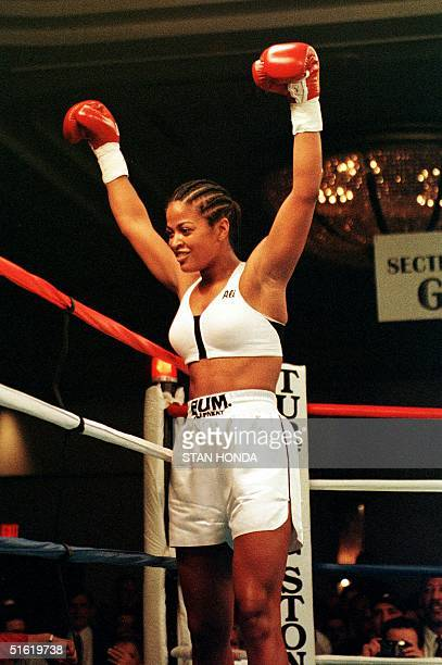 Laila Ali of Los Angeles daughter of boxing great Muhammad Ali raises her arms in celebration after knocking out April Fowler of Michigan City...