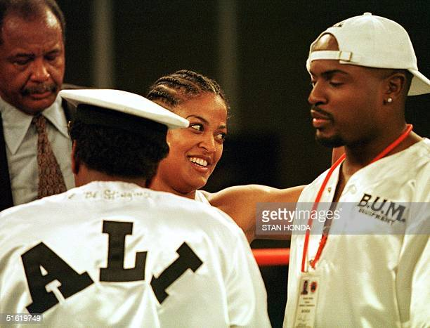 Laila Ali of Los Angeles daughter of boxing great Muhammad Ali smiles at a friend in the crowd as she celebrates her victory over April Fowler of...