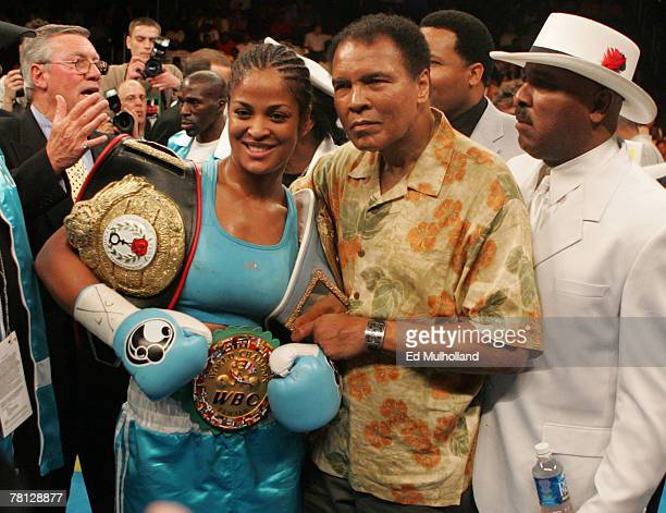 Laila Ali poses with her father Muhammad Ali after her 10 round WBC/WIBA Super Middleweight title bout with Erin Toughill at the MCI Center in...