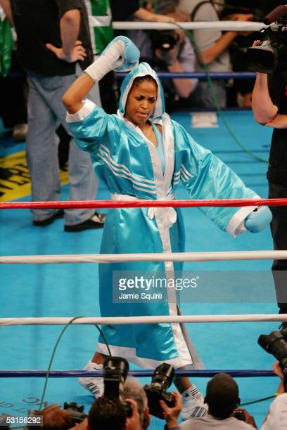 Laila Ali pumps her arm as she walks around the ring before her WBC and WIBA Super Middleweight Title bout against Erin Toughill on June 11 2005 at...