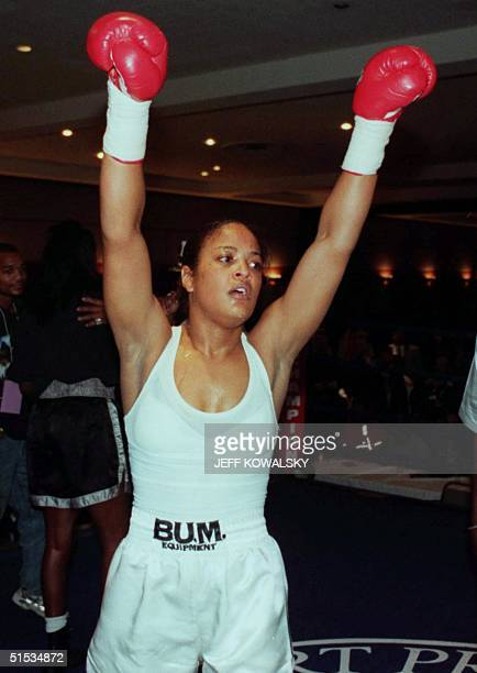 Laila Ali raises her arms after defeating Nicolyn Armstrong during the second round of their fight at Cobo Hall in Detroit on 10 December 1999 Ali...