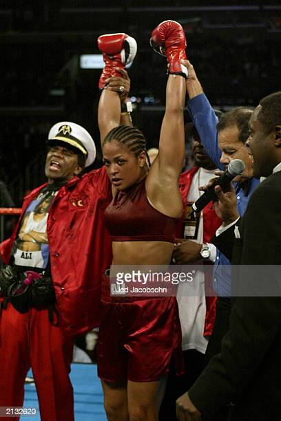 Laila Ali raises her hands after her TKO over Valerie Mahfood in their women's super middleweight bout at the Staples Center on June 21 2003 in Los...
