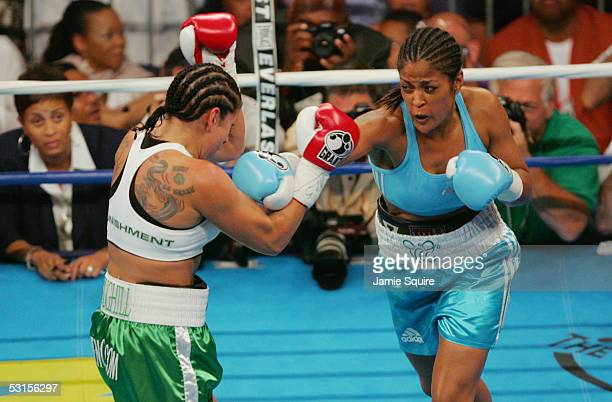 Laila Ali throws a punch at Erin Toughill during their WBC and WIBA Super Middleweight Title bout on June 11 2005 at the MCI Center in Washington DC