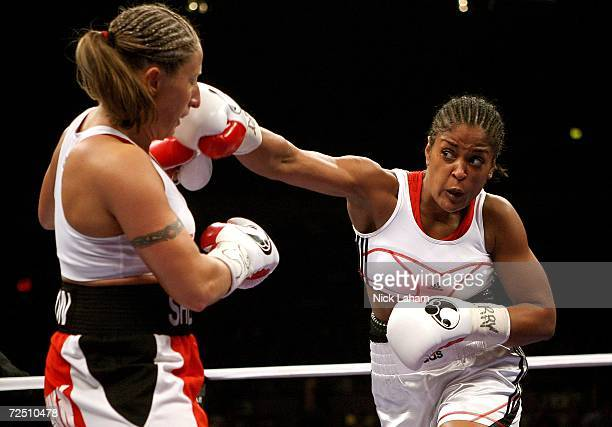 Laila Ali throws a right to Shelley Burton during the WBC Super Middleweight Championship bout on November 11 2006 at Madison Square Garden in New...
