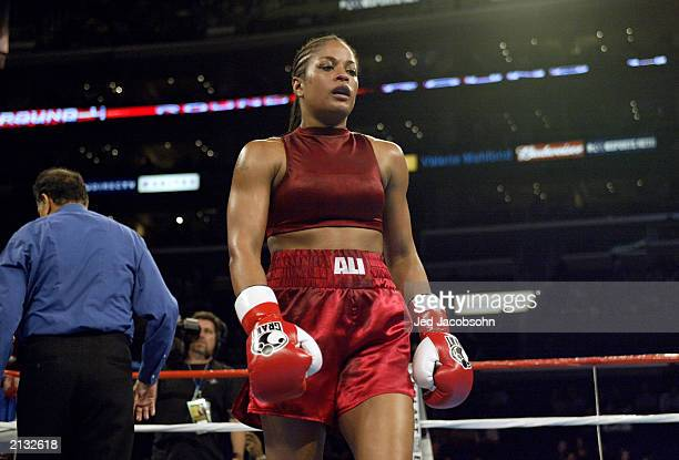 Laila Ali walks to the corner against Valerie Mahfood during their women's super middleweight bout at the Staples Center on June 21 2003 in Los...