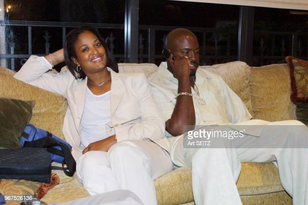 Laila AliMcClain 23 daughter of Muhammad Ali smiling as her husband Johnny Yahya McClain CEO of Absoloot Boxing uses his cell phone while Muhammad...