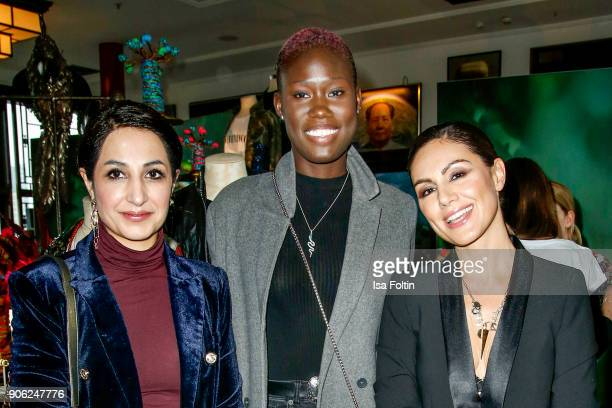 Laila Hamidi model Aminata Sanogo and German presenter Nazan Eckes attend the Thomas Sabo Press Cocktail during the MercedesBenz Fashion Week Berlin...
