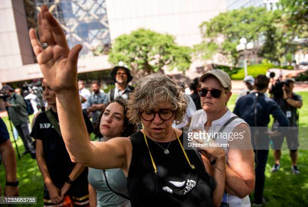 Laila Ibrahim joins people in prayer outside the Hennepin County Government Center after Judge Peter Cahill announced the sentencing of Derek Chauvin...