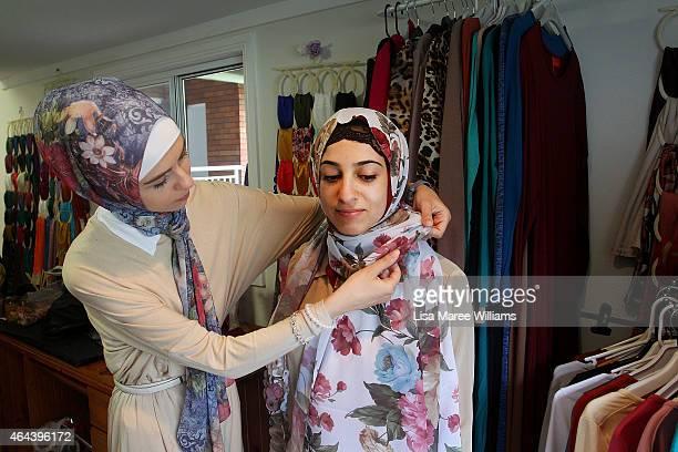 Laila Saboune assists a customer with her veil at Sara Elmir's home clothing studio on December 4 2014 in Bankstown Australia Sara Elmir 26 and...