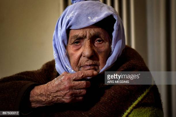 Laila Saleh, a 110 years old Syrian refugee from Kobane, poses for photographes, in Athens on December 15, 2017. Laila Saleh, who was born in Kobane...