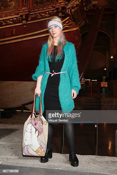 Laila wears a H M jacket a Fle Marc belt a Calcedonia's shoes a hand made hair ribbon and a Lost Found handbag at the '080 Barcelona Fashion Week...